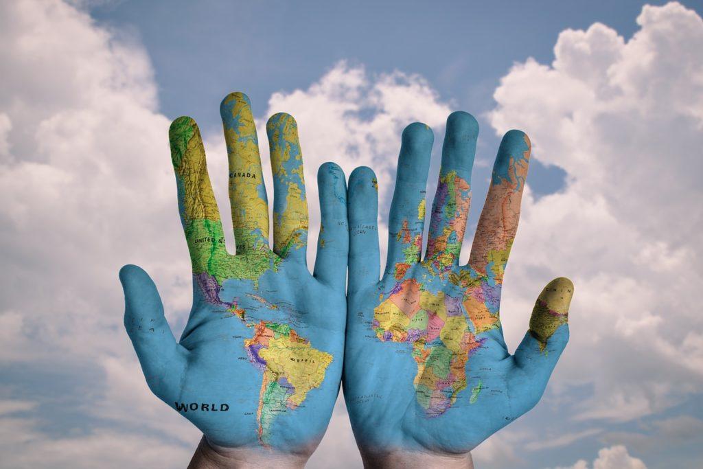 world-map-hands